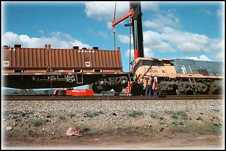 Cranes lift the last derailed wagon